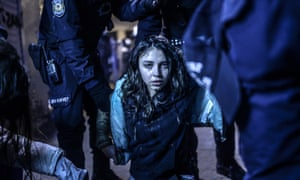 A young girl is pictured after she was  wounded during clashes between riot-police and prostestors after the funeral of Berkin Elvan, the 15-year-old boy who died from injuries suffered during last year's anti-government protests, in Istanbul on March 12, 2014. Riot police fired tear gas and water cannon at protestors in the capital Ankara, while in Istbanbul, crowds shouting anti-government slogans lit a huge fire as they made their way to a cemetery for the burial of Berkin Elvan.