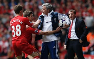 27 April: Jose Mourinho keeps the ball despite the efforts of Steven Gerrard during the Premier League match between Liverpool and Chelsea which handed momentum in the title race back to Manchester City