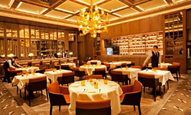 Round tables and chandeliers at the Dorchester Grill