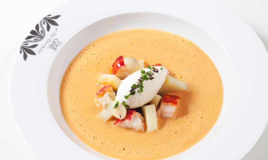 The lobster bisque, piled with lobster, in a round bowl