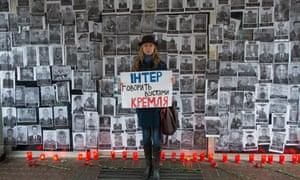 A Ukrainian activist protests against a Russian propaganda TV series.