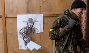 Ukrainian soldiers use a poster of Russian actor Mikhail Porechenkov for target practice. Porechenkov is said to have joined separatist militia shooting at the Donetsk airport.