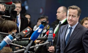 David Cameron addresses the media as he arrives for an EU summit in Brussels.