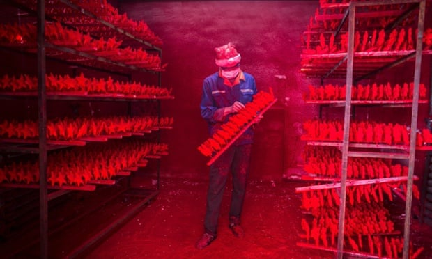 The two men produce 5,000 red snowflakes a day, and get paid around £300 a month.