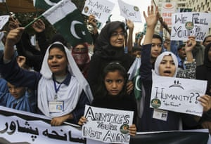 Pakistani students chant slogans to condemn the  Taliban attack on the military-run school in Peshawar.