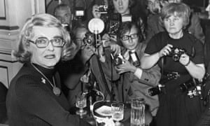 Jane Bown pushes to the front of a scrum of 'snappers' to photograph Bette Davis in London in 1975