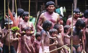 Davi Kopenawa, Yanomami leader and shaman surrounded by children, Demini, Brazil.
