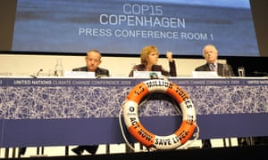 Executive-secretary of the UN climate conference Yvo de Boer (L), Danish Minister of UN Climate Change Conference Connie Hedegaard  (C) and Eric Hall, communications officer attend a press conference at the Bella center of Copenhagen on December 15, 2009 on the 9th day of the COP15 UN Climate Change Conference.