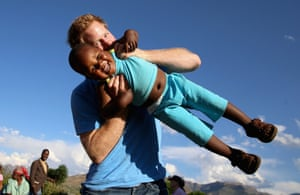 Prince Harry swings a three-year-old orphan boy called Lerato in this photograph taken with the help of a three-year-old blind girl called Karabo during a visit to Phelisanong children's home in Maseru, Lesotho