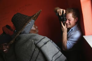 Prince Harry takes a photograph during a visit to a herd boy night school constructed by Sentebale in Mokhotlong, Lesotho