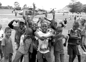 Basotho children posing for the camera after Prince Harry disembarked an army helicopter: <em>'These are children who have never had the chance to talk about their illness, and who had no idea that they were one of so many in their age group. It was really emotional watching them interact with each other'</em>