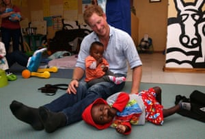Prince Harry plays with two young children, who are going through a programme for malnourishment
