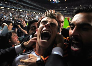 24 May: Real Madrid's Gareth Bale celebrates with teammates after scoring his side's second goal in the Champions League final against Atletico Madrid at the Luz Stadium in Lisbon, Portugal, thereby helping Real to win 'La Decima'