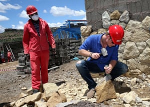 Britain's Prince Harry helps with sandstone cladding for the guardhouse as he visits the construction site for the new Sentebale Mamohato Children's Centre at Thaba-Bosiu in Maseru