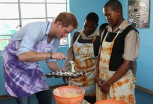 Prince Harry cooks at the Thuso centre for children living with multiple disabilities on in Bute-Bute, Lesotho