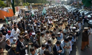Activists of Jamaat ud Dawa offer memorial prayers for the victims of an attack by Taliban gunmen on an army-run school in Peshawar, in Lahore.