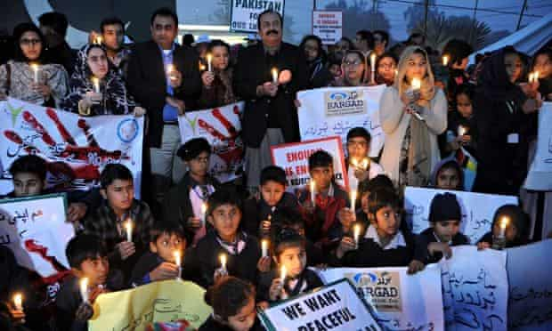 Pakistanis attend a candlelight vigil to mourn those killed in the Peshawar school attack