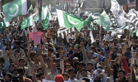 Activists of Jamaat ud Dawa shout slogans for the victims of an attack by Taliban gunmen on an army-run school in Peshawar, in Lahore.