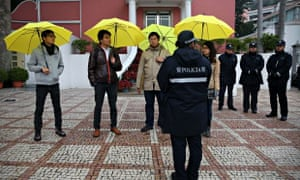 Macau protesters holding yellow umbrellas