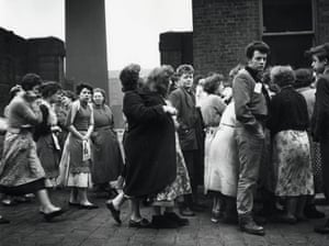 Rochdale by election, 1958.  Voters from a cotton mill wait to be addressed by one of the candidates