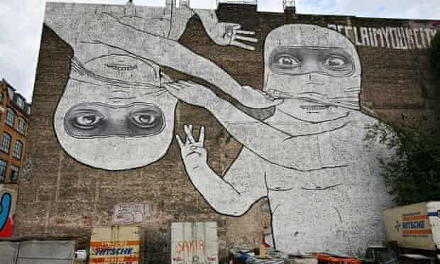 One of the two murals in Kreuzberg by Italian artist Blu.