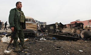 Kurdish fighter at bomb site