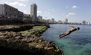 Cuba boy jumps into the water at the Malecon in Havana