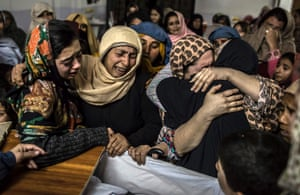 Women mourn their relative Mohammed Ali Khan, 15, a student who was killed during an attack by Taliban gunmen on the Army Public School, at his house in Peshawar, Pakistan