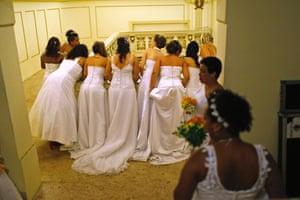 Brides from Santa Marta slum wait for their group wedding to begin in Rio de Janeiro, Brazil