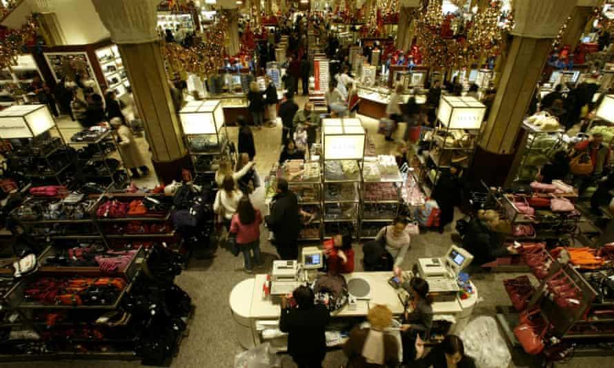 Crowds pass through Macy's in New York.