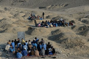 Afghan schoolchildren study at an open-air classroom in the Mohmand Dara district in eastern Nangarhar province