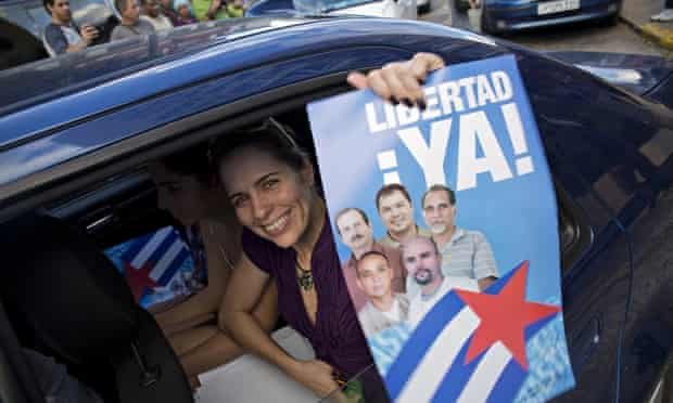 A woman in Havana with a poster of the Cuban Five celebrates their release from a Flordia jail after