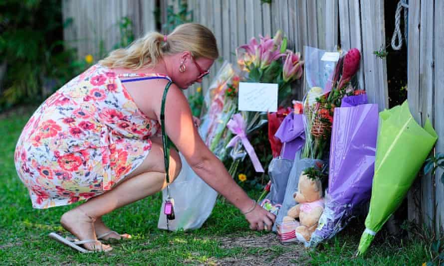 Woman lays flowers near scene of Cairns stabbings
