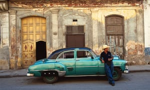 1950s American car and local man in Old Havana.