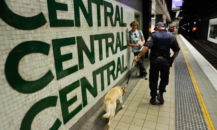 A NSW police officer patrols with a sniffer dog at Central station in Sydney in 2012.