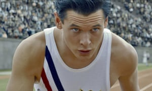 Jack O'Connell as Louis Zamperini on an athletics track in Unbroken