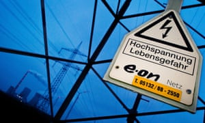 A sign reading 'High voltage Danger to Life' and the logo of energy company Eon at a power line near the cole-fired power plant of Mehrum in Hohenhameln, near Hanover, Germany, 1 December 2014. According to news reports, Eon plans to change its company strategy. The Germany-based energy giant wants to focus on renewable energy, energy networks and customer solutions, and intends to get rid of the nuclear, coal and gas energy divisions.