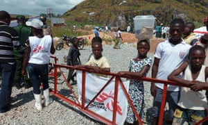 Children stand outside a an MSF centre financed by France to treat Ebola patients in Macenta, Guinea.