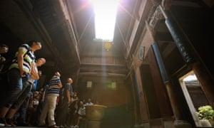 HUANGSHAN, CHINA - JUNE 12: Tourists visit an ancient house on June 12, 2014 at Hongcun Village, China.
