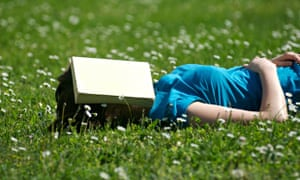 Student reading / sleeping in the park / garden with a book over her face