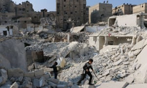 Syrian boys play in the rubble of Aleppo.