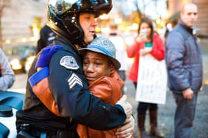 'The cop appears to be comforting the boy. After all the anger, all the divisions, here is a moment of human reconciliation. What nonsense.'