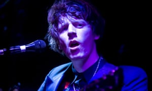 Blaine Harrison performs on stage with The Mystery Jets