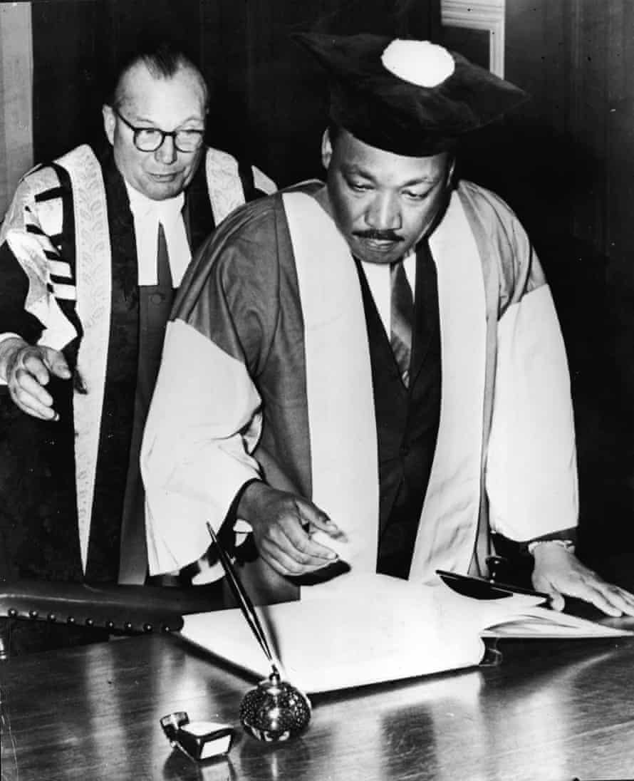 King signs the degree roll at Newcastle University after receiving his honorary doctorate in civil law, November 1967.