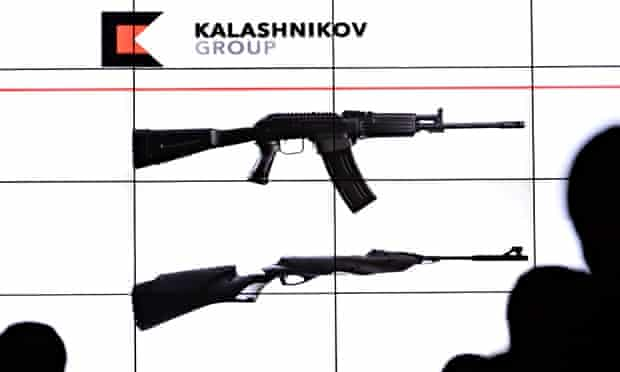 People watch the presentation of the rebranded Kalashnikov company in Moscow. The firm is trying to