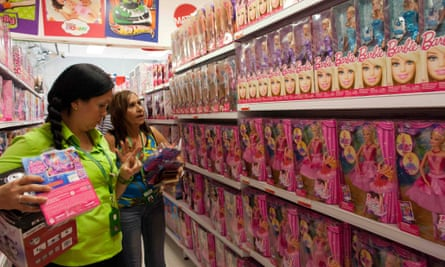 Shoppers look at Barbie dolls for sale in Caracas.