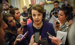 Senator Diane Feinstein talks with reporters on the release of the Senate CIA report on 9 December.