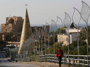 A Christmas tree made from gold-coloured iron leaves, stands at the entrance of the ancient city of Byblos in Beirut