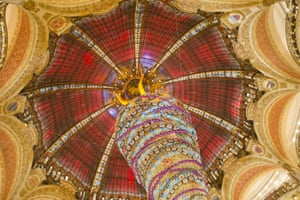 An upside down Christmas tree stands at the centre of the department store Galeries Lafayette in Paris, France.
