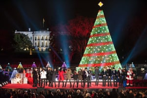 Performers sing during the National Christmas Tree Lighting Ceremony on the Ellipse, south of the White House in Washington, DC, US